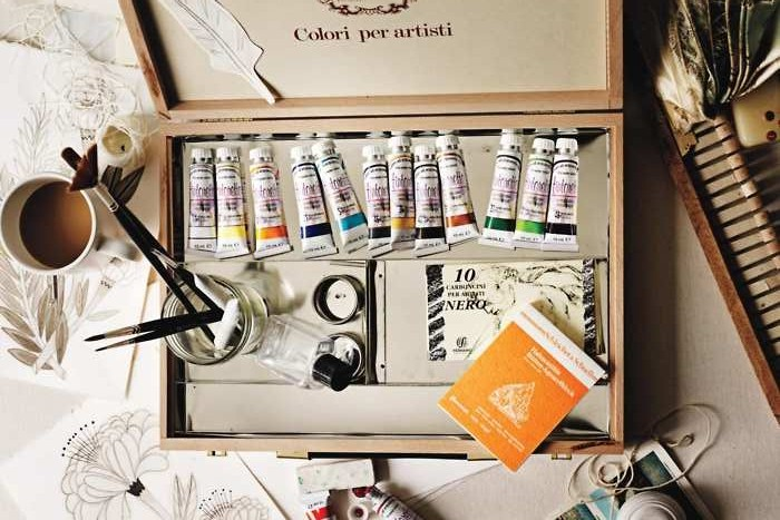Open box of art supplies - the secret to getting started