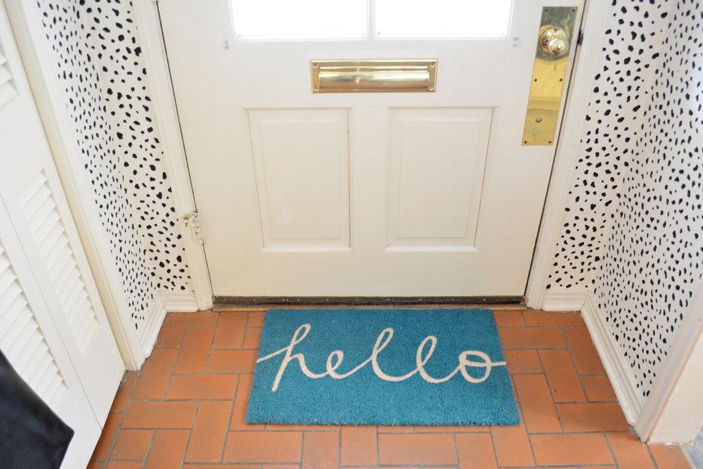 """Hello"" welcome mat and dalmatian print walls by interior stylist @lesleymyrick"