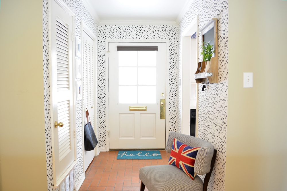 Black and white dalmatian print foyer - an eclectic makeover by interior stylist @lesleymyrick