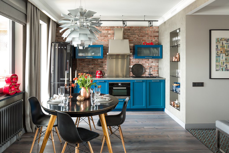 Unexpected Colorful Kitchens roundup from designer Lesley Myrick | Blue cabinets and a killer chandelier