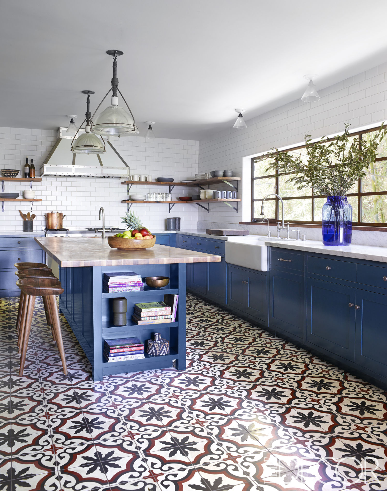 Unexpected Colorful Kitchens roundup from designer Lesley Myrick | Royal blue kitchen cabinets with Moroccan tile floor