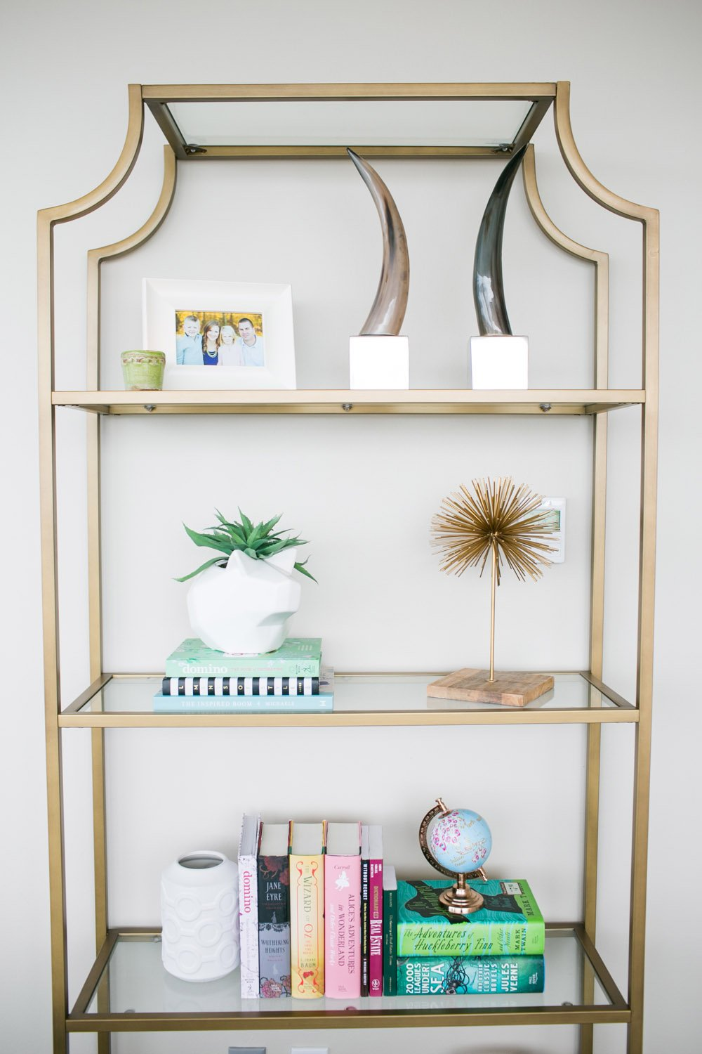 designer-styled bookshelf with large scale decorative accessories