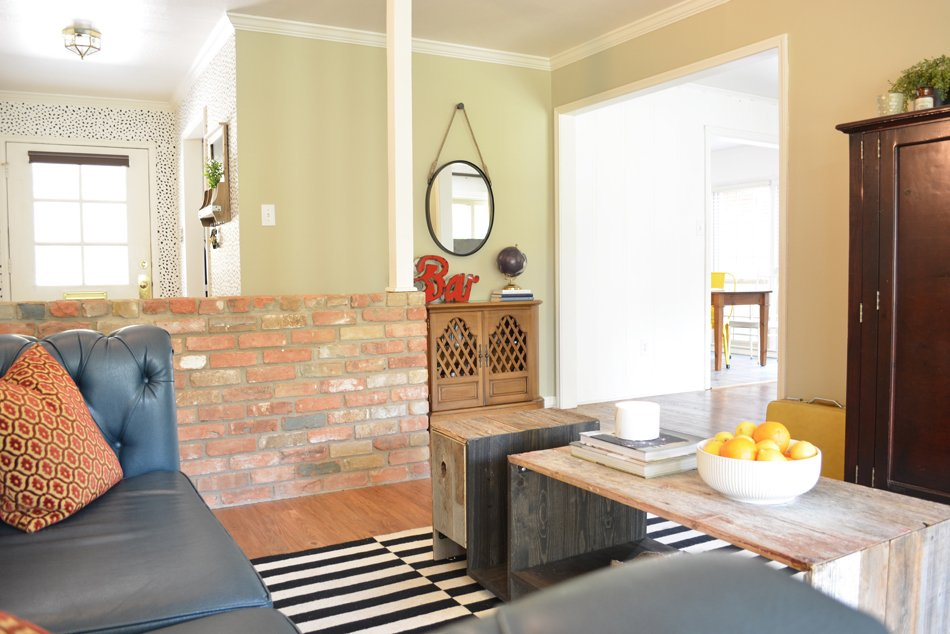 Before and After: A Family-Friendly Living Room with a Teal Sofa and Vintage Bar