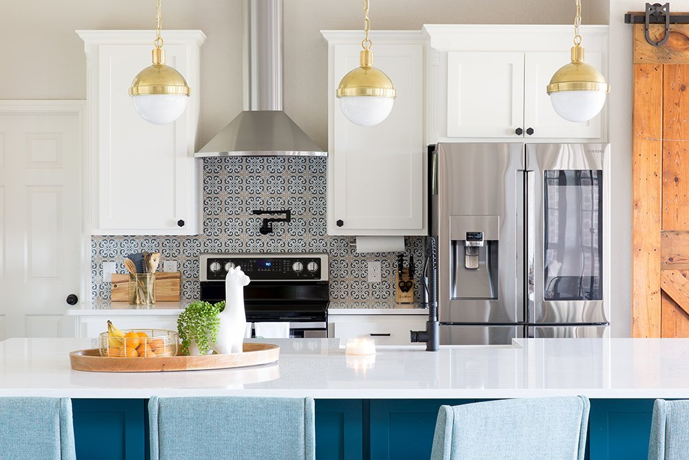 A modern blue kitchen in Waco Texas that's totally family-friendly