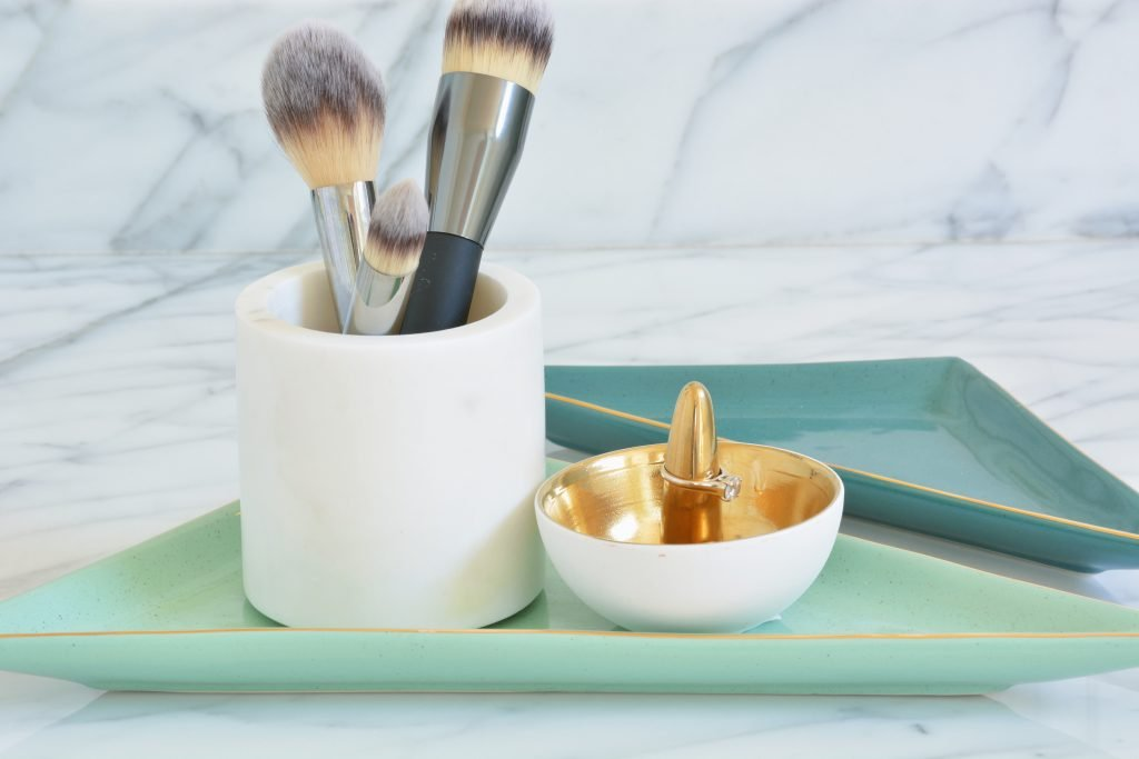 Bathroom organizing tip from Atlanta interior designer Lesley Myrick: trays are your best friend! It's amazing how one little tray can really help a space feel complete - and it's an easy way to infuse an otherwise sterile space with a little of your awesome personality.