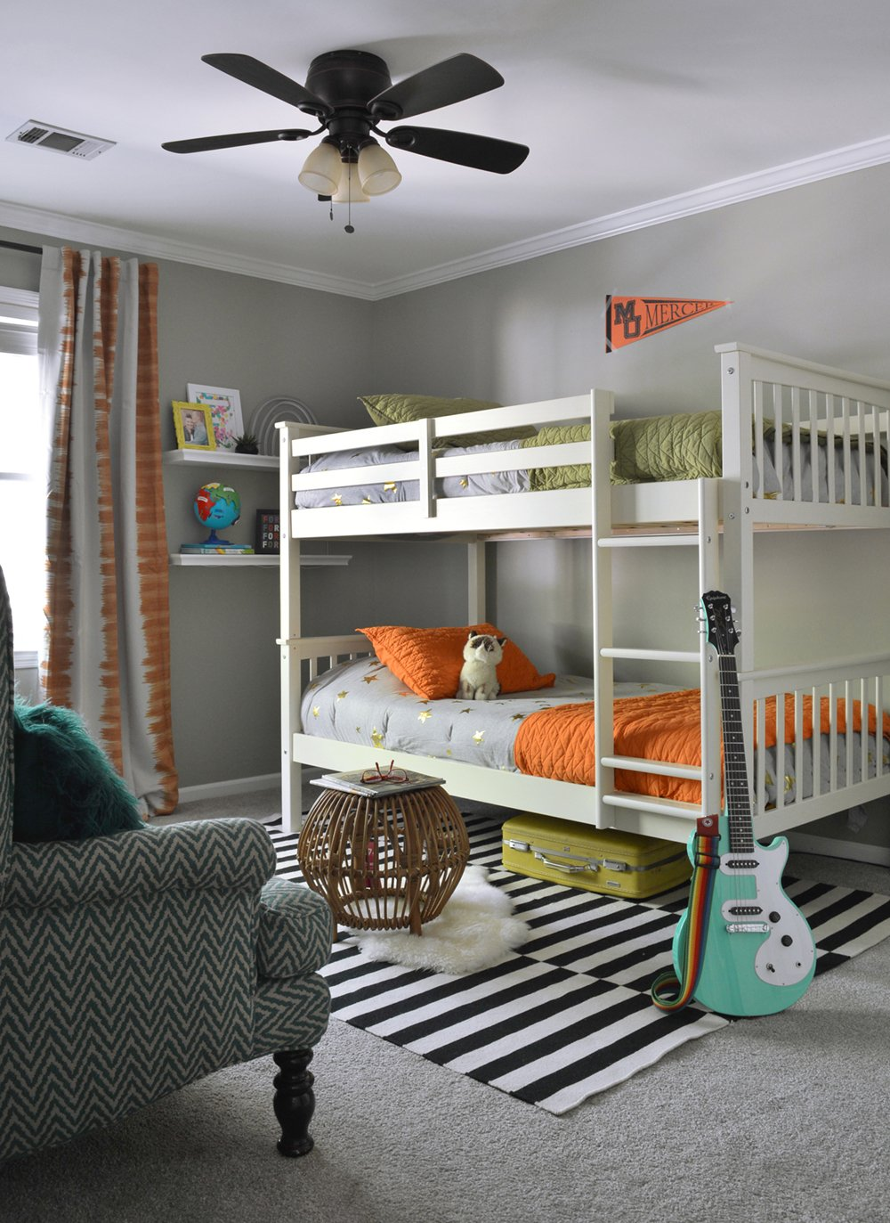 Love this colorful boy's bedroom with bunk beds and pops of orange, green, and teal.