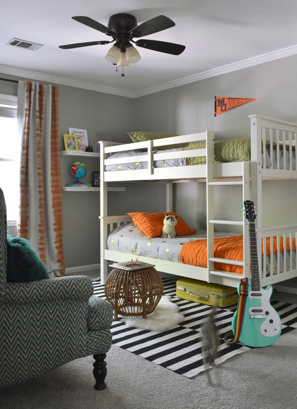 Love this colorful boy's bedroom with bunk beds! Wall color is Sherwin-Williams Chatroom.