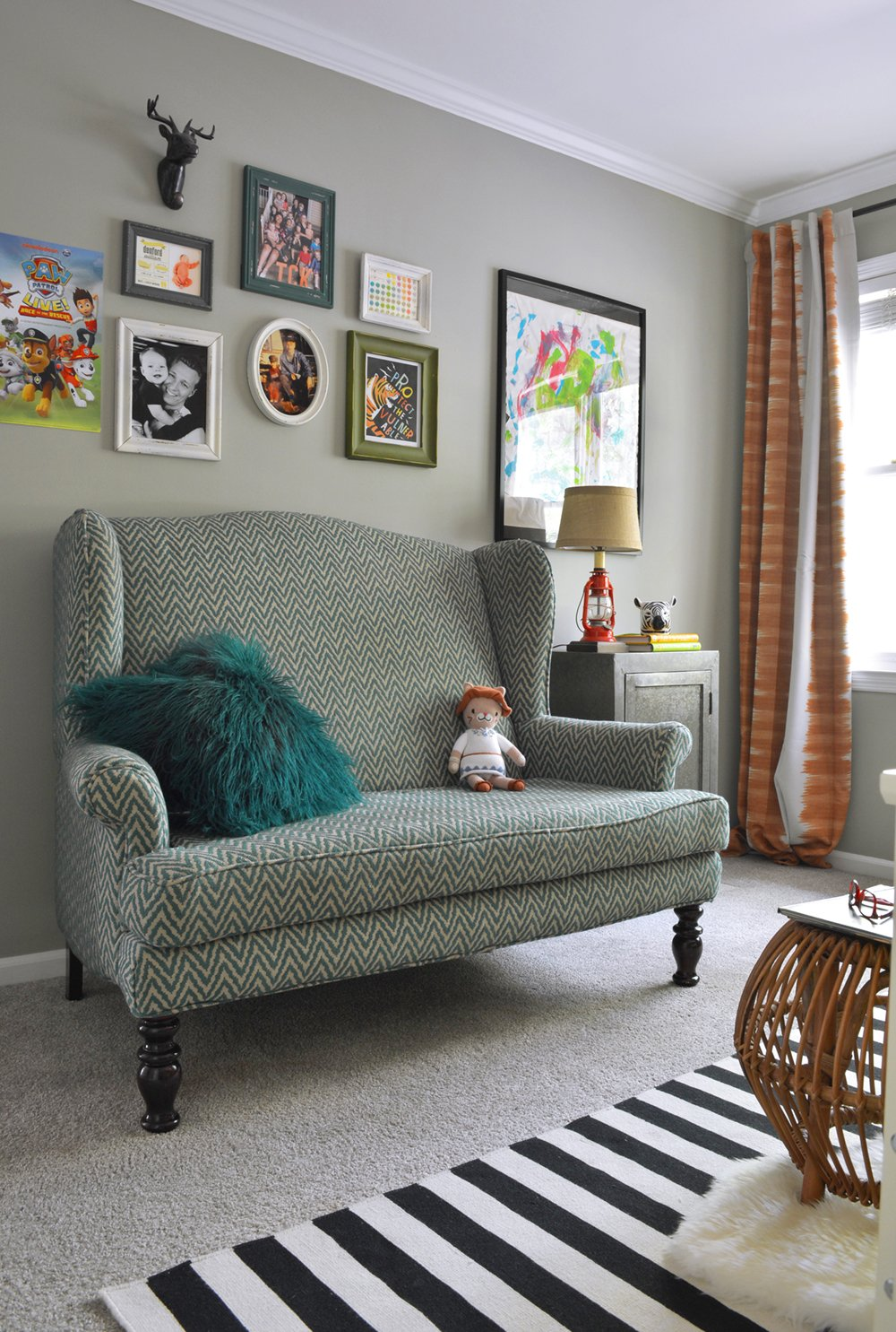 Love this fun teal chevron sofa in a kids bedroom.