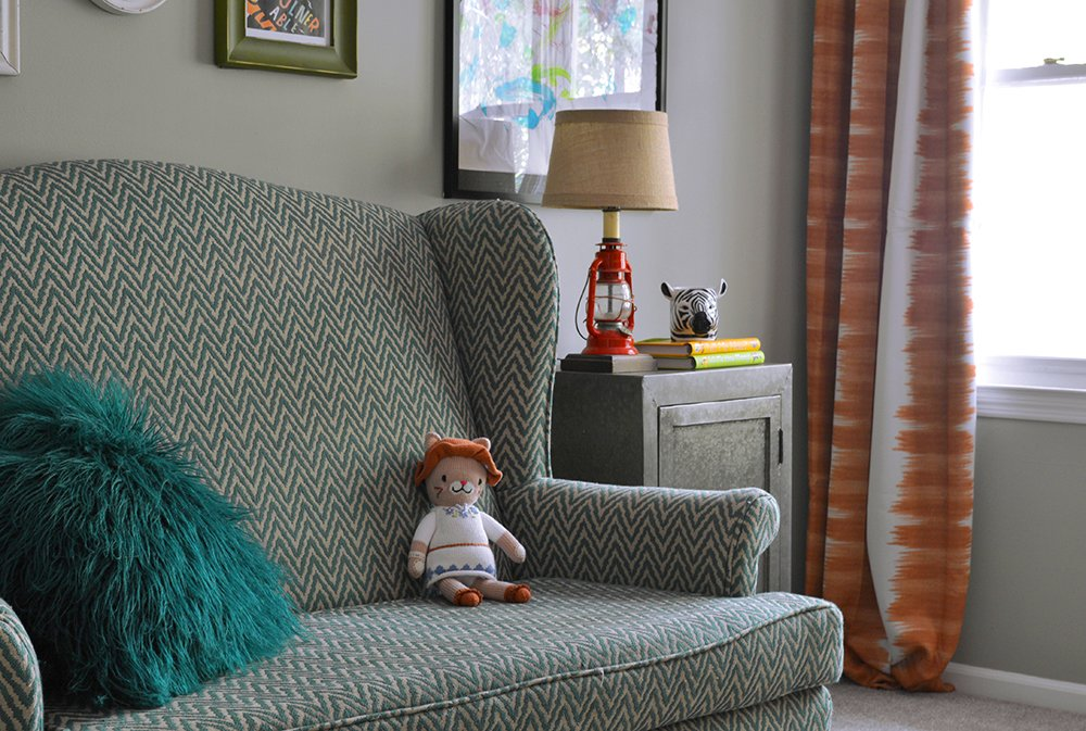 Love this fun teal chevron sofa  and fur pillow in a kids bedroom.