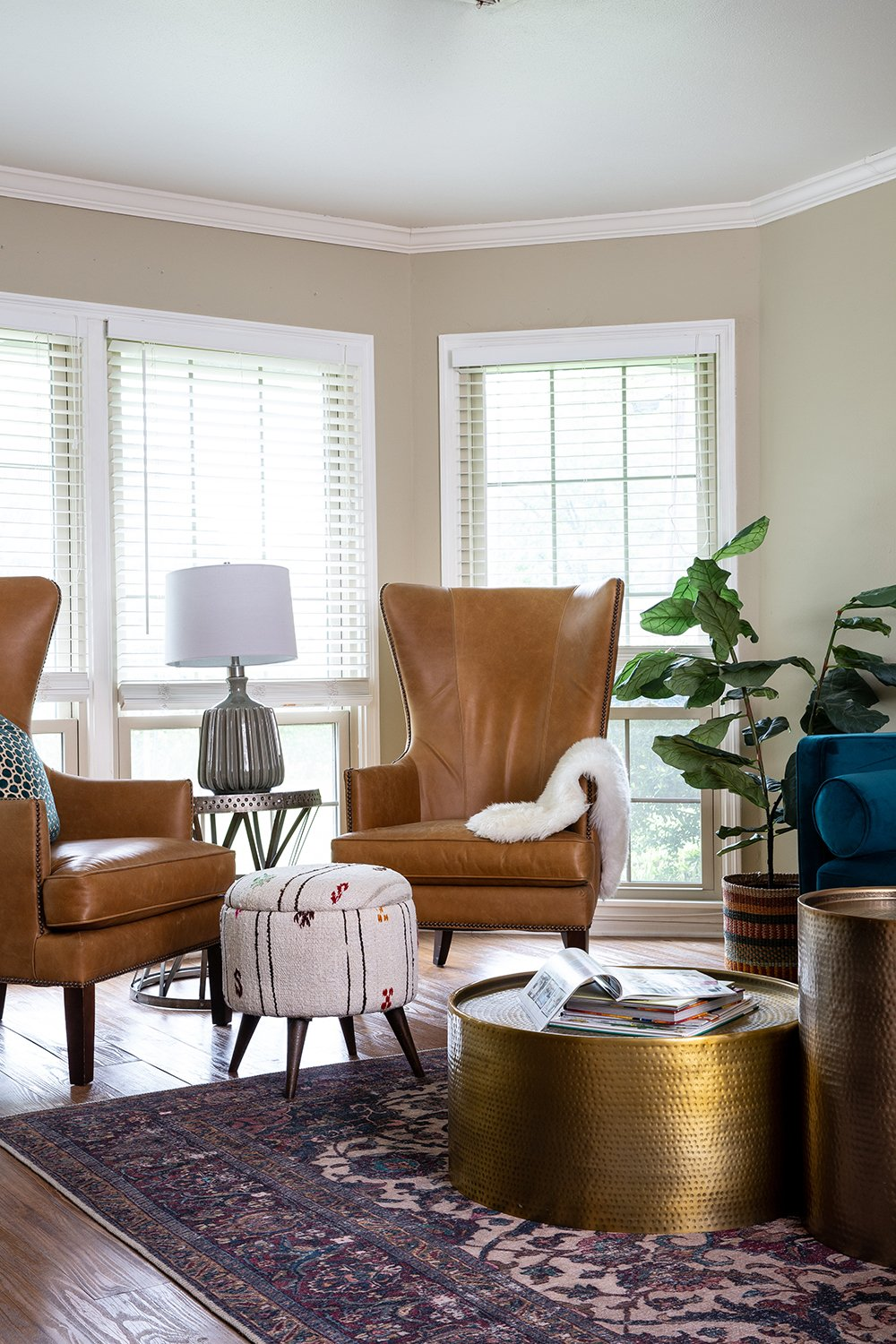 Before and After: A Family-Friendly Texas Living Room with Leather Accent Chairs by interior designer Lesley Myrick