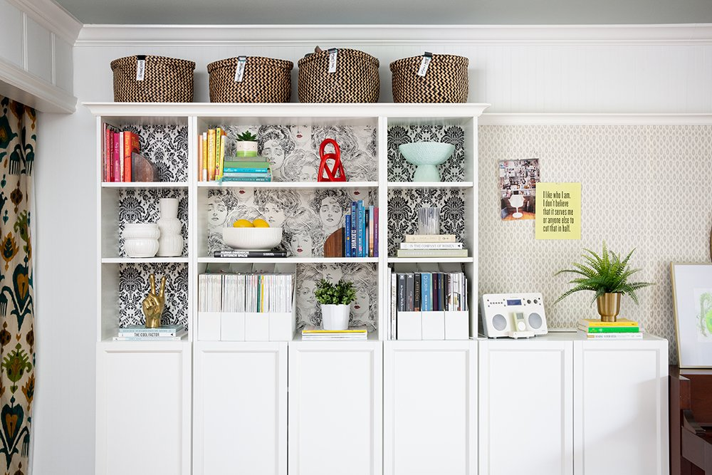 Awesome built-in bookshelves in an interior designer's home office
