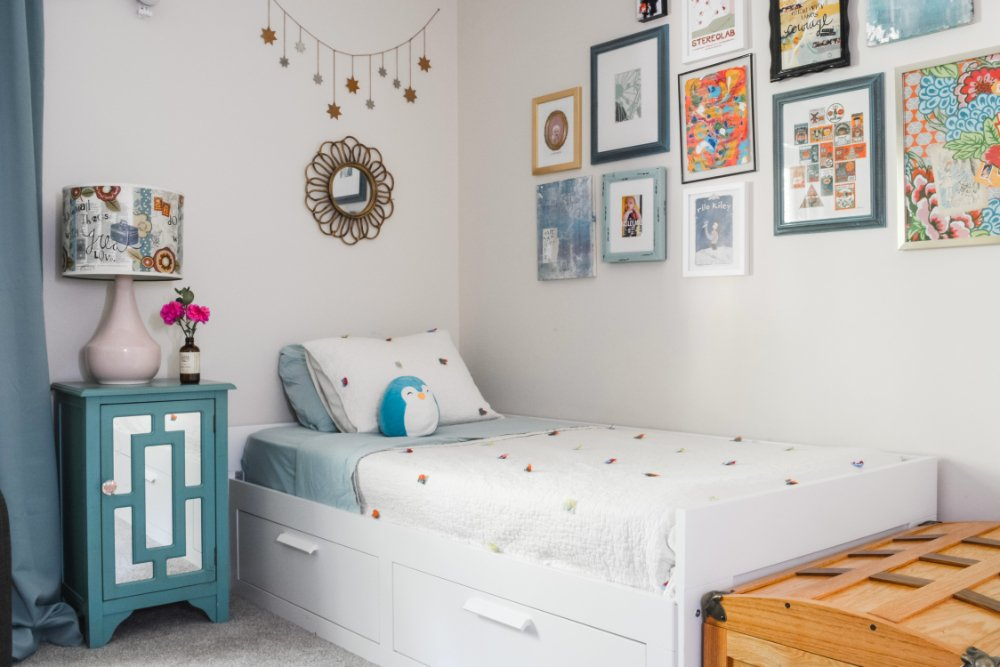 A cute girl's bedroom with white, aqua, and pink