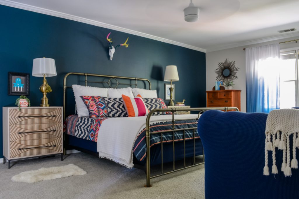 Love the navy accent wall in this bedroom! It's Sherwin-Williams Dark Night.