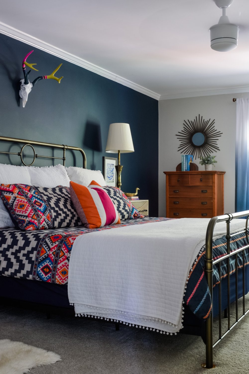 A navy bedroom by interior designer Lesley Myrick