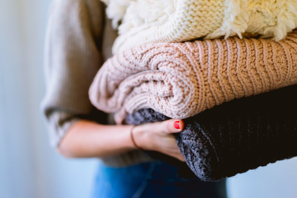 Cozy blankets help create hygge holiday vibes at home.